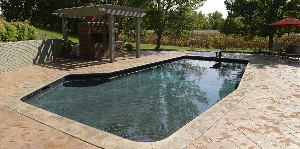 This pool in Iowa City, Iowa is over 25 years old! Proper construction and design techniques have ensured that the pool operates well and looks good!